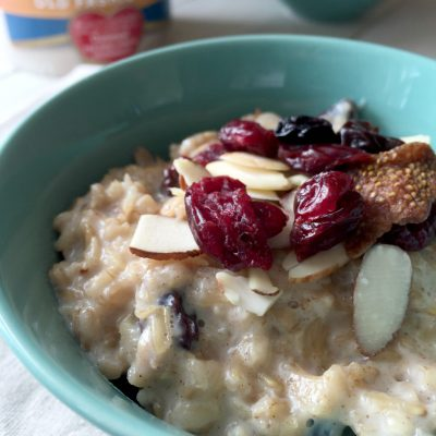 Oatmeal bowl with brown sugar and dried fruits